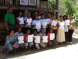 "Farmers show their ""Adopt a Rice Terrace"" certificates"