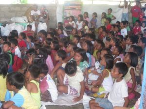 Children in the Salvacion school watching a film