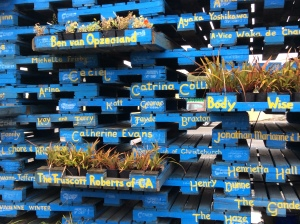 Pallets with their sponsors' names - and plants