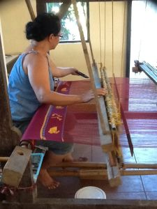 This weaver is weaving the sinamay sashes for the University of the Philippines graduation.