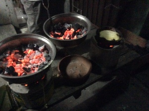 Two charcoal braziers and a bibingka just cooked