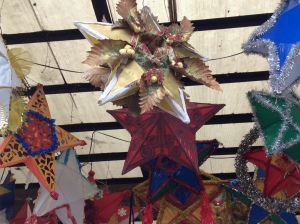 The parol in front has an open center, a niche for a Christmas scene