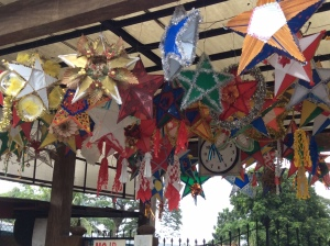 In the upper right, a reed or thin bamboo decorates the parol