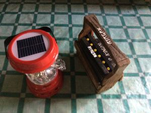 Battery and solar lamp