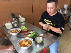 "Bao contemplates our breakfast of ""bún riều""."