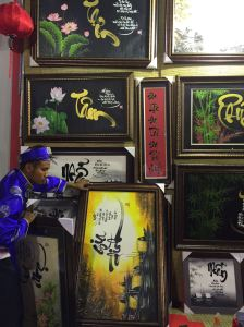 Young art students show their paintings at a Têt street market in Saigon.